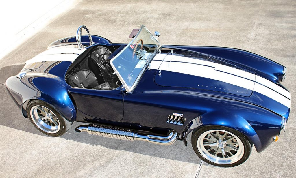 elevated broadside shot of Indigo Blue Backdraft Racing Shelby Cobra replica for sale, BDR1260