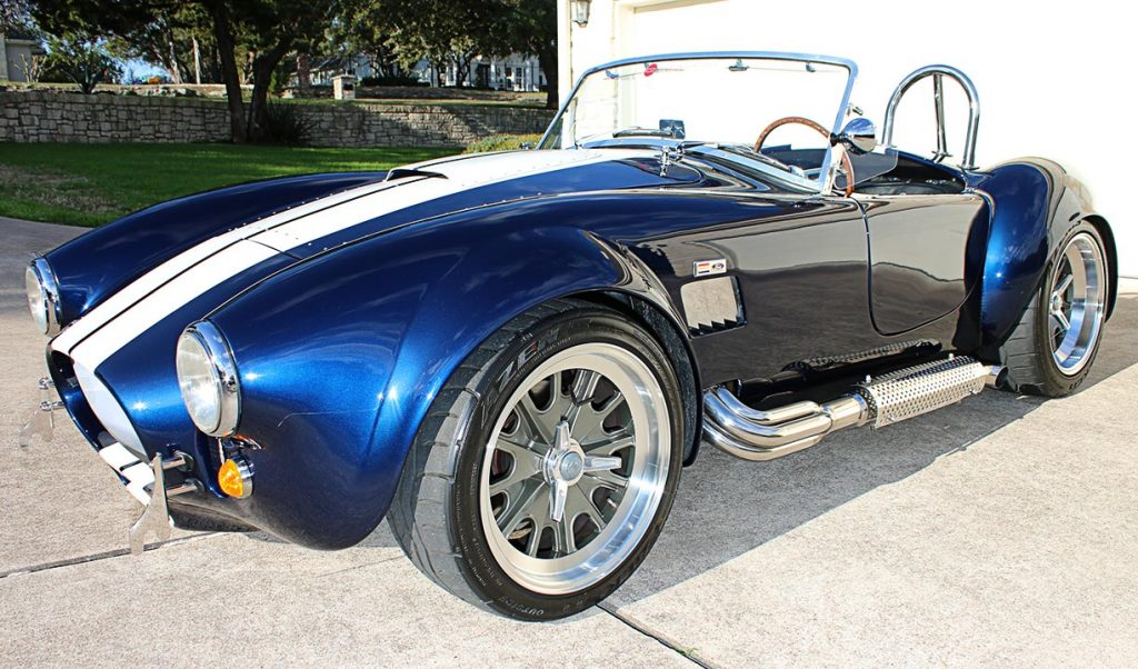 3/4-frontal shot (driver side) of Indigo Blue Backdraft Racing Shelby Cobra replica for sale, BDR1260