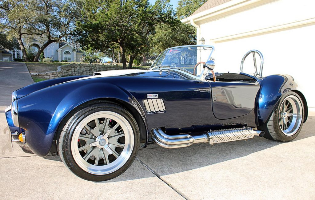 broadside shot (driver side) of Indigo Blue Backdraft Racing Shelby Cobra replica for sale, BDR1260