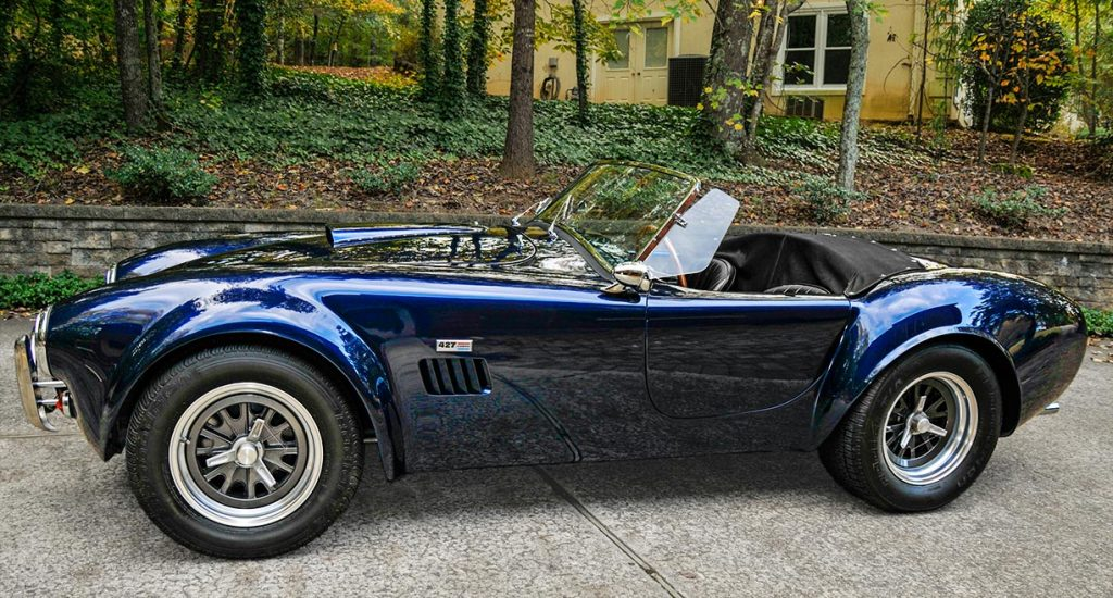 broadside shot (driver side) of Shelby Navy Blue Contemporary Classic 427 'Street Version' Shelby Cobra for sale, CCX-3-3835