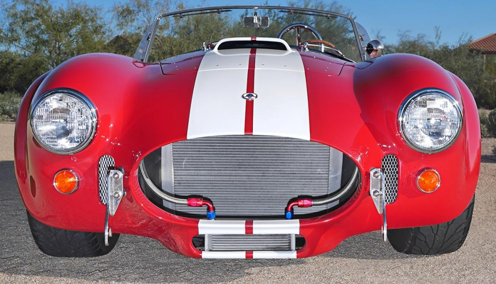 dramatic head-on frontal shot of Monza Red Superformance 427SC Shelby classic Cobra for sale, SPO2051