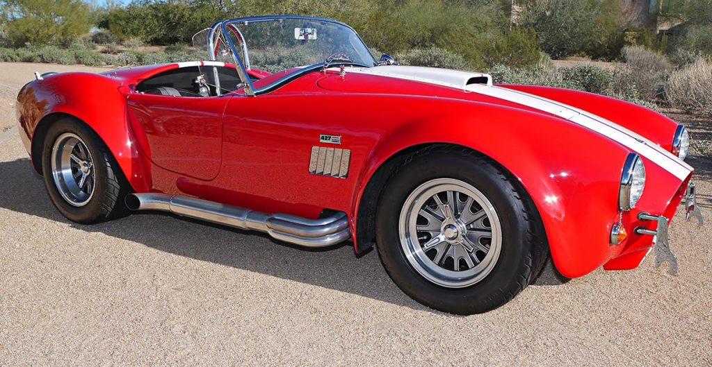 broadside shot (passenger side) of Monza Red Superformance 427SC Shelby classic Cobra for sale, SPO2051