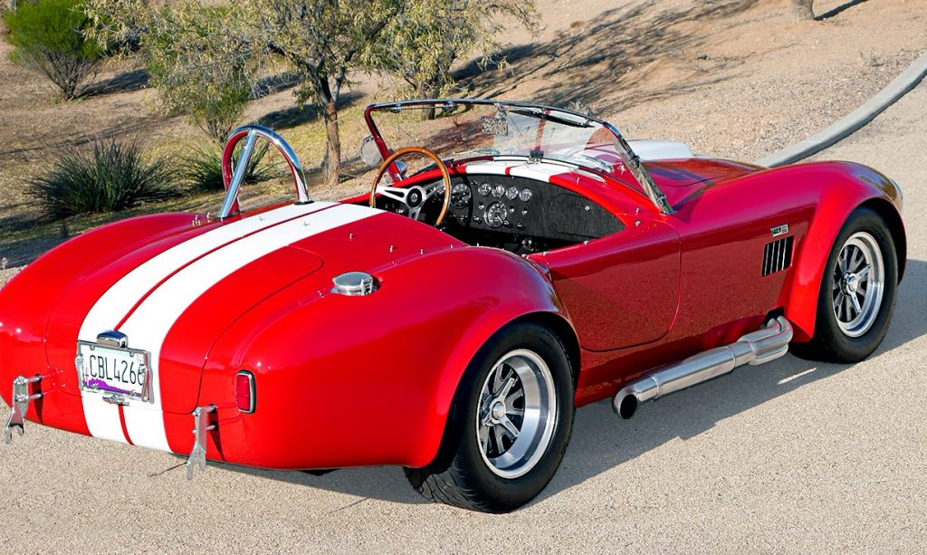 3/4-rear shot (passenger side) of Monza Red Superformance 427SC Shelby classic Cobra for sale, SPO2051