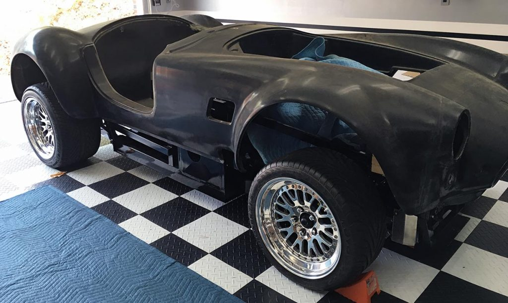 3/4-frontal view of uncompleted West Coast Cobra for sale, replica of classic Shelby 427 Cobra