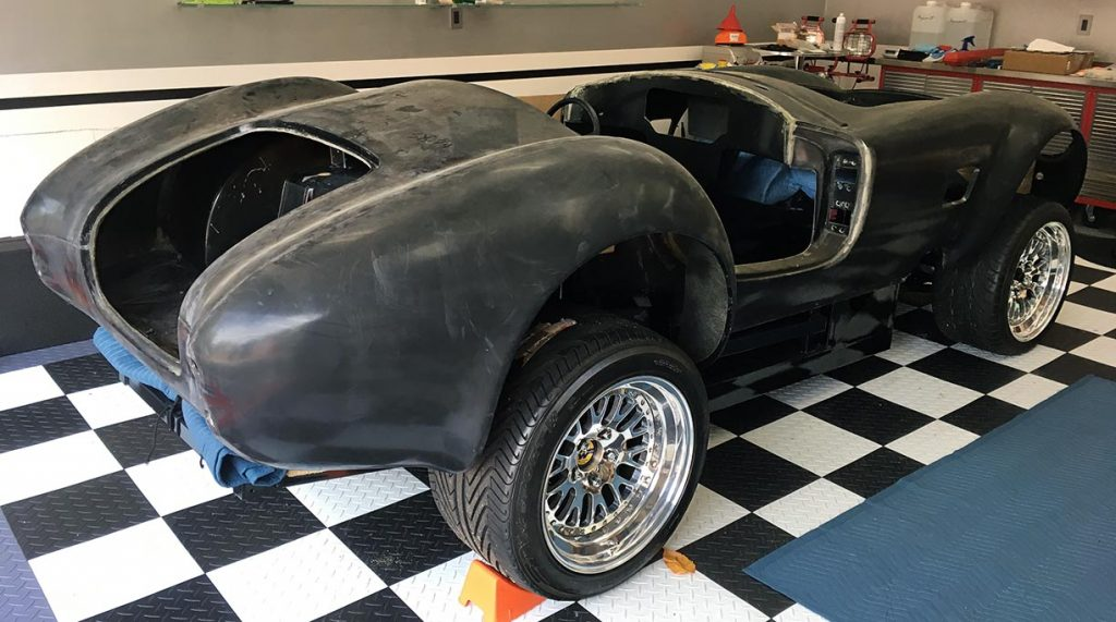 3/4-rear shot of this uncompleted West Coast Cobra for sale, replica of classic Shelby 427 Cobra