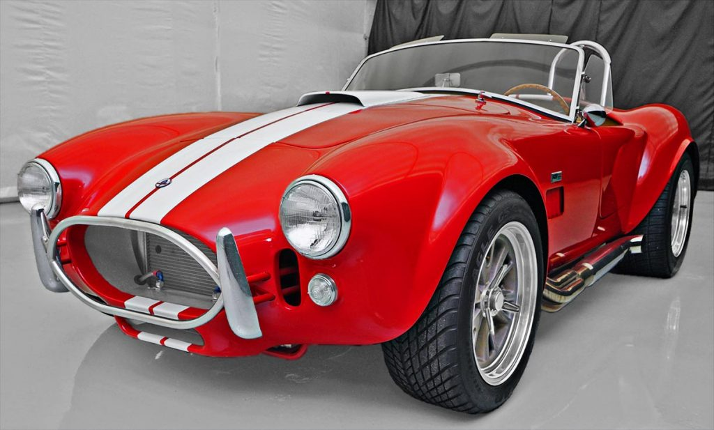 3/4-frontal shot (driver side) of Guards Red Contemporary Classic 427SC Shelby Cobra for sale, CCX-3-3422