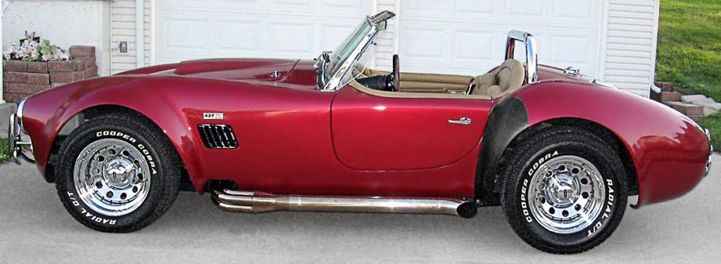 broadside shot (driver side) of Candy Apple Red West Coast 427SC Shelby classic Cobra for sale
