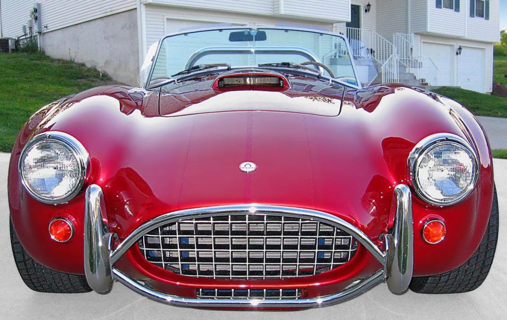 head-on frontal shot (driver side) of Candy Apple Red West Coast 427SC Shelby classic Cobra for sale