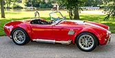 broadside shot thumbnail image of Deep Red Backdraft Racing 427SC Shelby classic Cobra for sale, BDR661