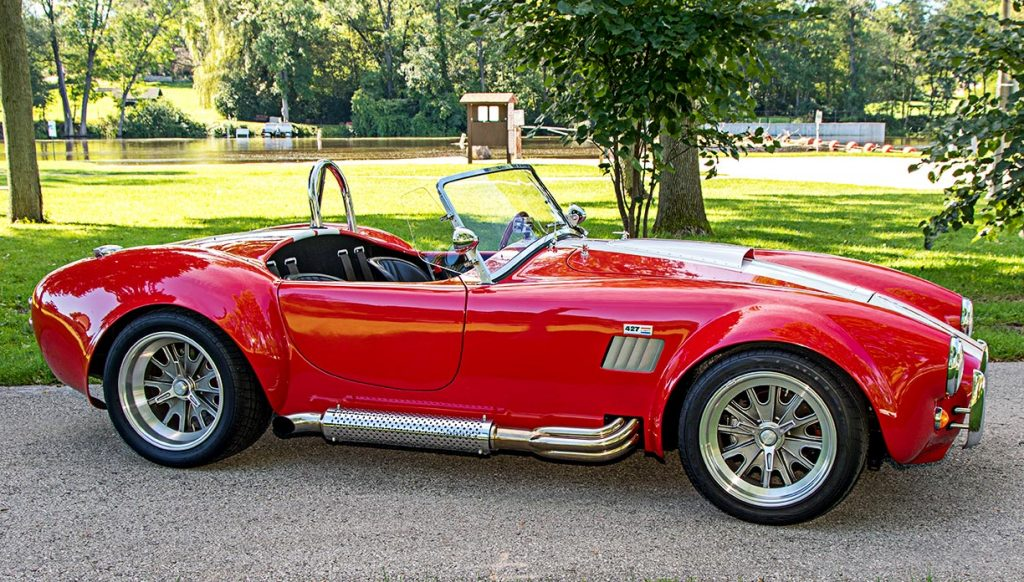 broadside shot (passenger side) of Deep Red Backdraft Racing 427SC Shelby classic Cobra for sale, BDR661