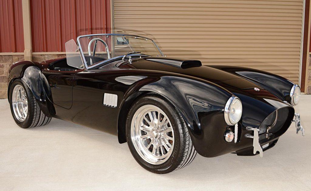 3/4-frontal shot (passenger side) of Onyx Black Superformance 427 Shelby classic Cobra street version Roadster for sale, SPO1869