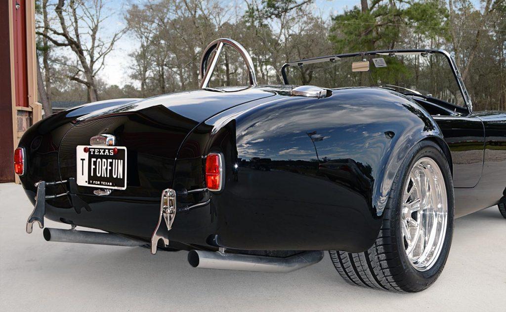 rear-quarter shot (passenger side) of Onyx Black Superformance 427 Shelby classic Cobra street version Roadster for sale, SPO1869