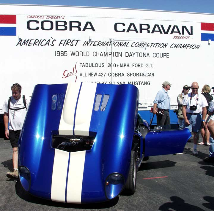 Peter Brock's blue Daytona Coupe in front of Carroll's 'Cobra Caravan' van, Laguna Seca 2003