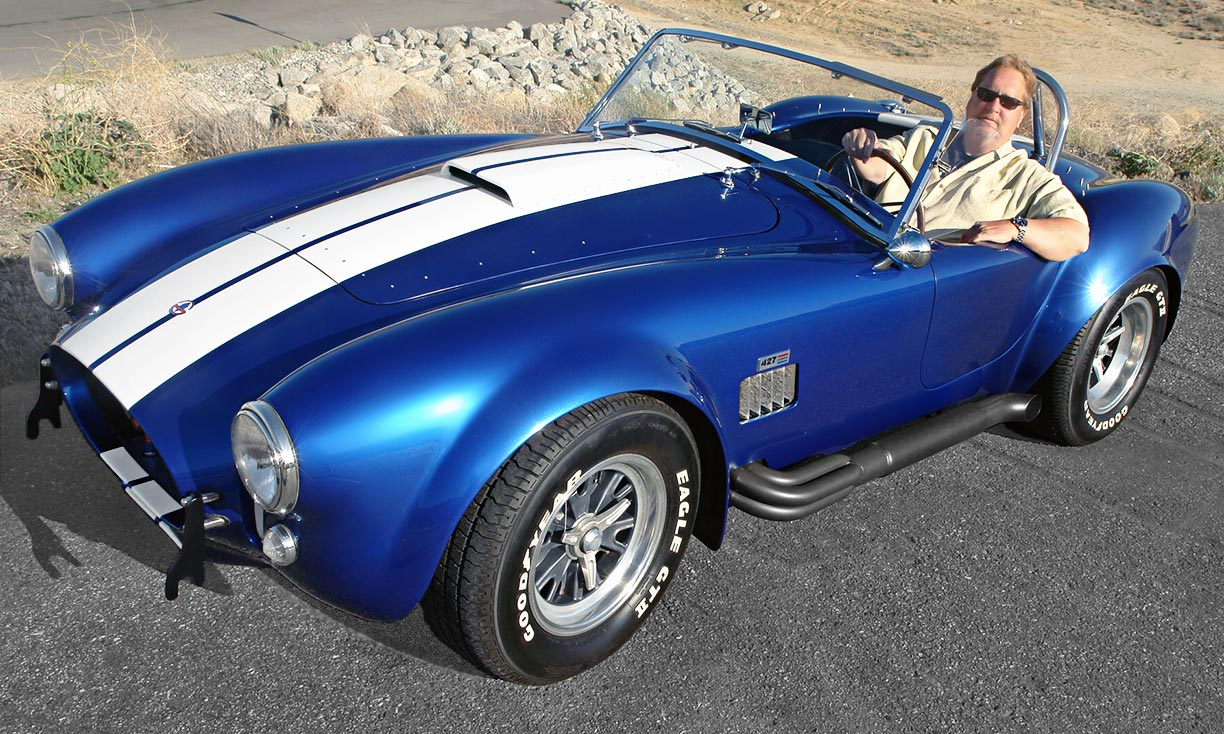3/4-frontal view#3 (Robb Allen behind the wheel) of Guardsman Blue Superformance 427SC Shelby classic Cobra for sale, SPO#0813