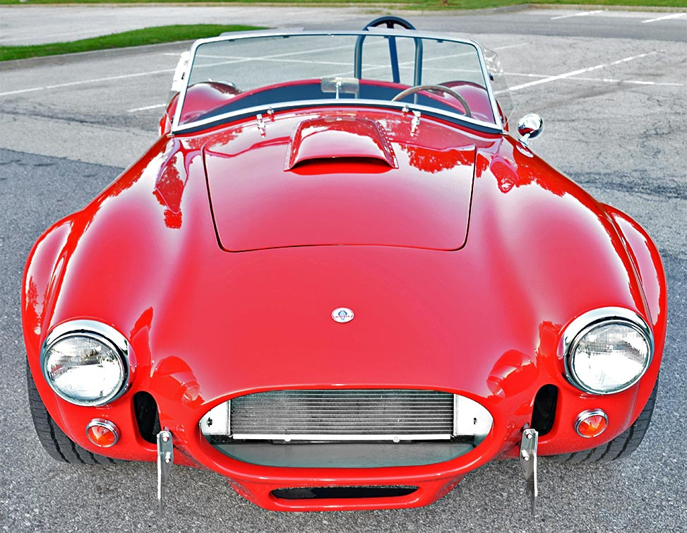 head-on frontal shot of Rangoon Red Hurricane Motorsports 427SC Shelby classic Cobra for sale, #HM1021