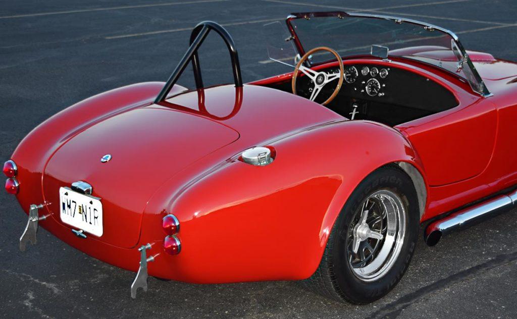 rear-quarter twilight shot (passenger side) of Rangoon Red Hurricane Motorsports 427SC Shelby classic Cobra for sale, #HM1021