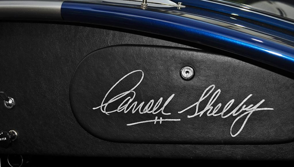 closeup photo of Carroll Shelby's personal autograph on glovebox door of Indigo Blue Superformance 427SC Shelby classic Cobra for sale, SPO2666