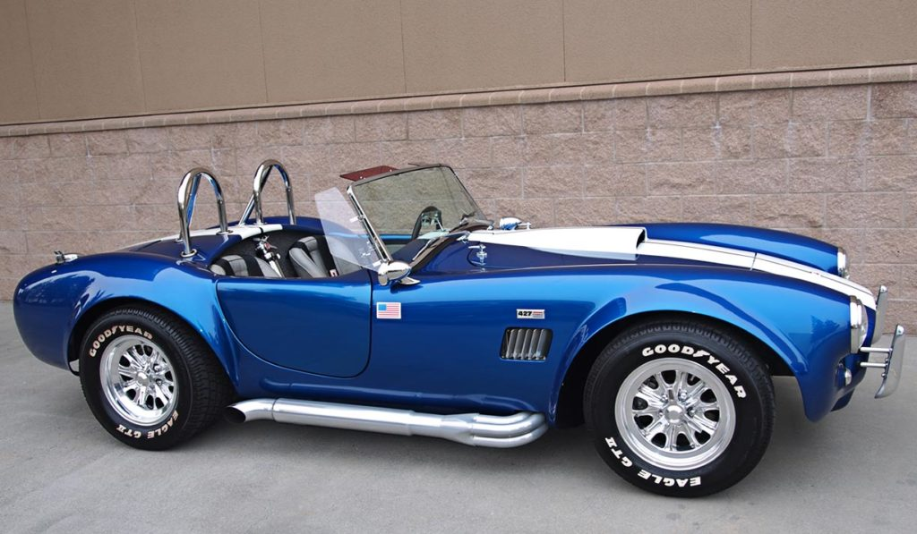 broadside shot of Pearl Blue classic 1965 Shelby Cobra vehicle, built by B&B/LA Exotics, for sale by owner