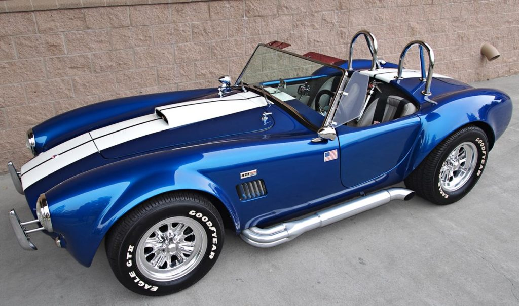 broadside shot (driver side) of Pearl Blue classic 1965 Shelby Cobra vehicle, built by B&B/LA Exotics, for sale by owner