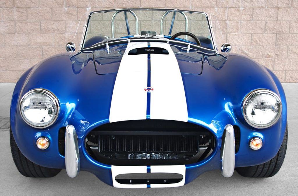 head-on frontal shot of Pearl Blue classic 1965 Shelby Cobra vehicle, built by B&B/LA Exotics, for sale by owner