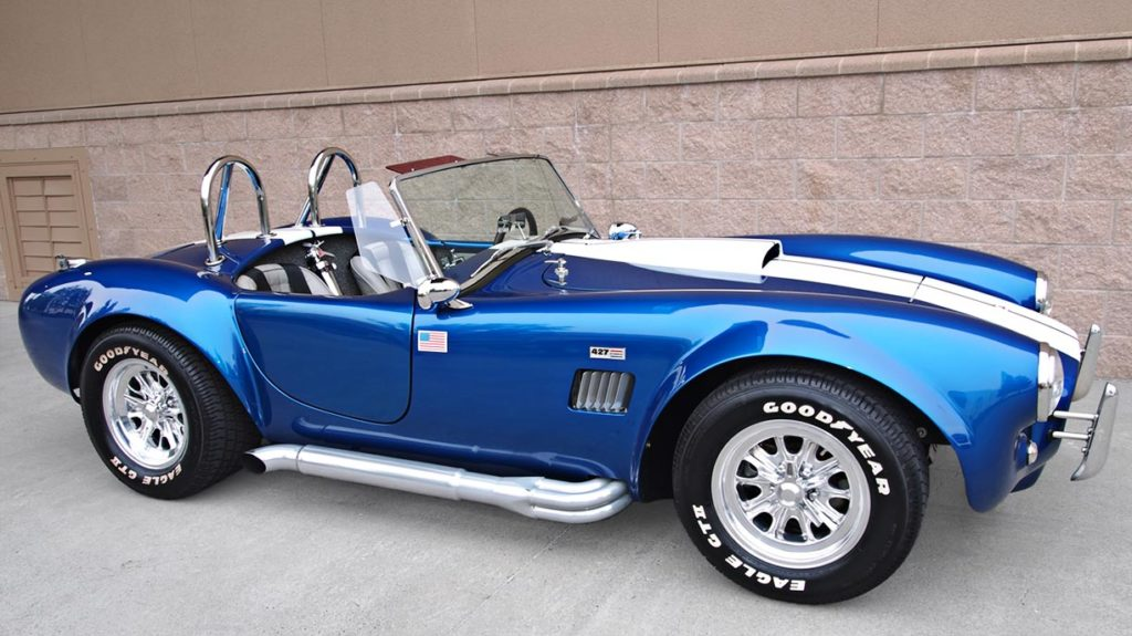 broadside shot (passenger side) of Pearl Blue classic 1965 Shelby Cobra vehicle, built by B&B/LA Exotics, for sale by owner