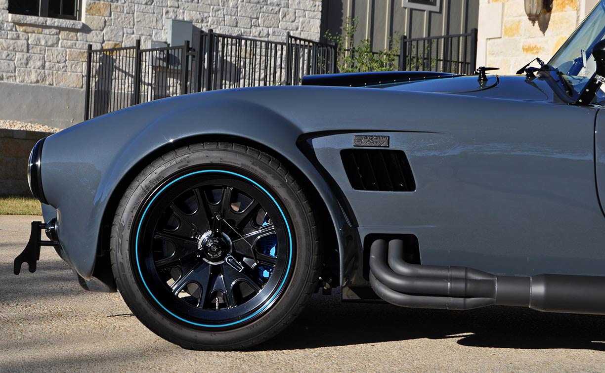 front fender and rolling stock shot of Porsche Graphite Blue Metallic Backdraft Racing GT Wide body 427SC Shelby classic Cobra replica for sale, BDR1758
