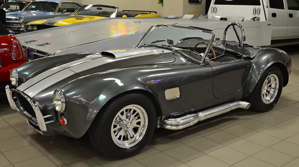 3/4-frontal shot (driver side) of Sterling Gray/silver stripes Unique Motorcars 427SC Shelby classic Cobra for sale by owner