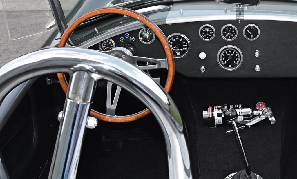dashboard shot of Sterling Gray/silver stripes Unique Motorcars 427SC Shelby classic Cobra for sale by owner
