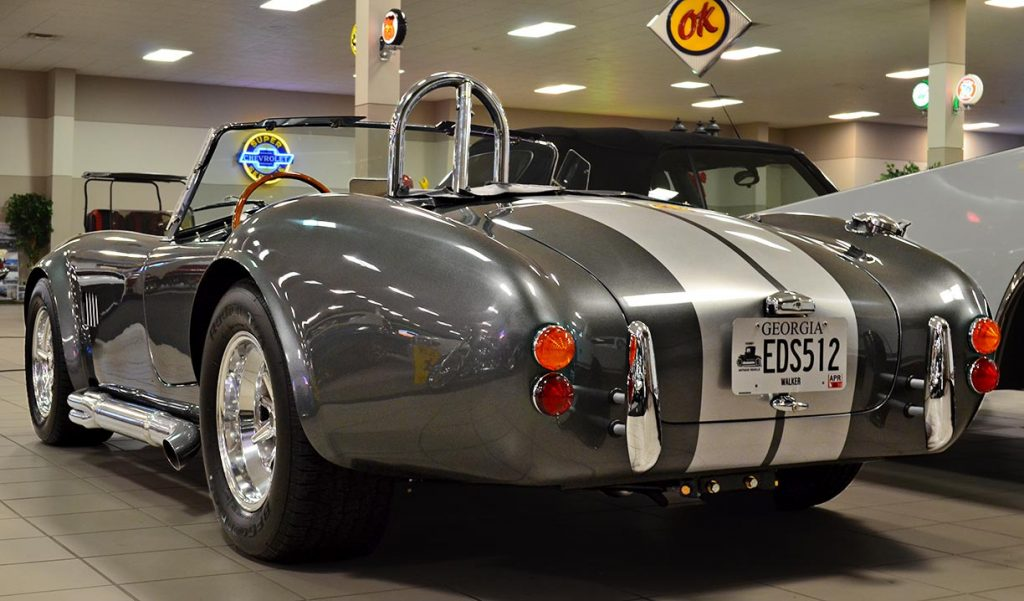 3/4-rear shot (driver side) of Sterling Gray/silver stripes Unique Motorcars 427SC Shelby classic Cobra for sale by owner