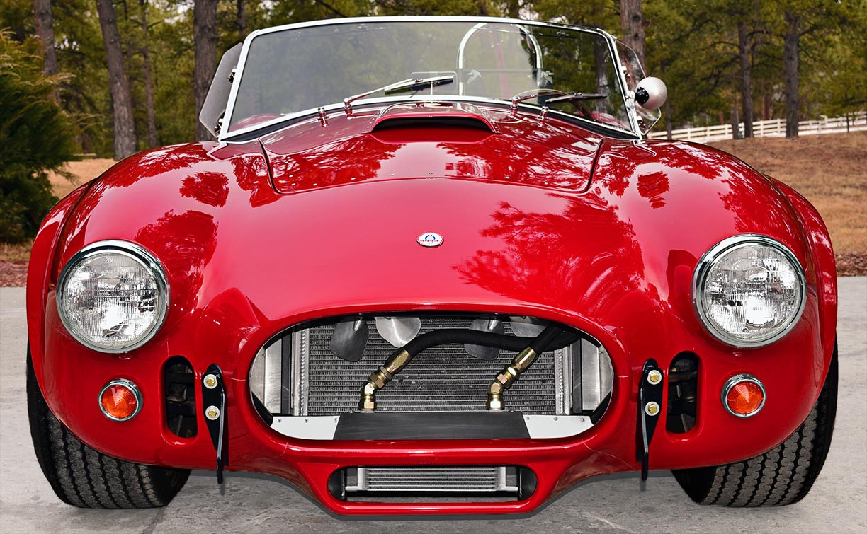 head-on frontal shot of Guards Red Shelby 427SC Shelby classic Cobra for sale, CSX4228