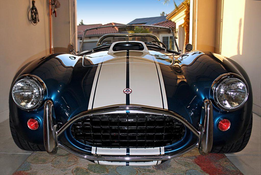 head-on frontal view of Guardsman Blue/Wimbledon White stripes West Coast Cobra, California SB-100, for sale