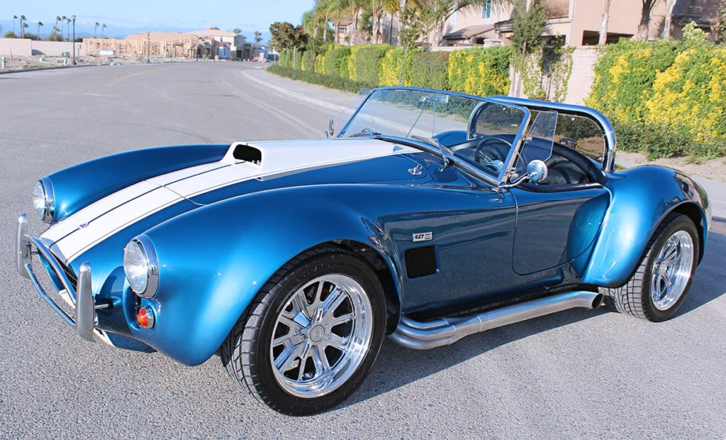 3/4-frontal view (driver side, lower camera angle) of Guardsman Blue/Wimbledon White stripes West Coast Cobra, California SB-100, for sale