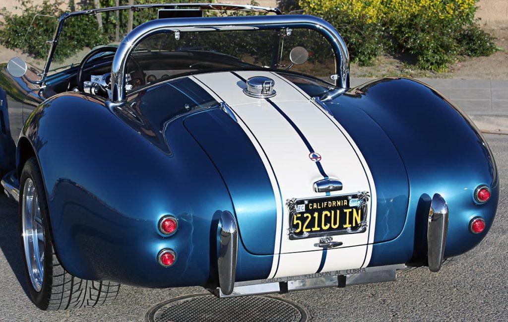 rear-quarter shot (driver side, alternate angle) of Guardsman Blue/Wimbledon White stripes West Coast Cobra, California SB-100, for sale
