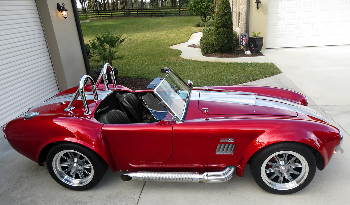 broadside shot#3 (passenger side) of metallic red Factory Five Racing MkII 427SC Shelby classic Cobra for sale
