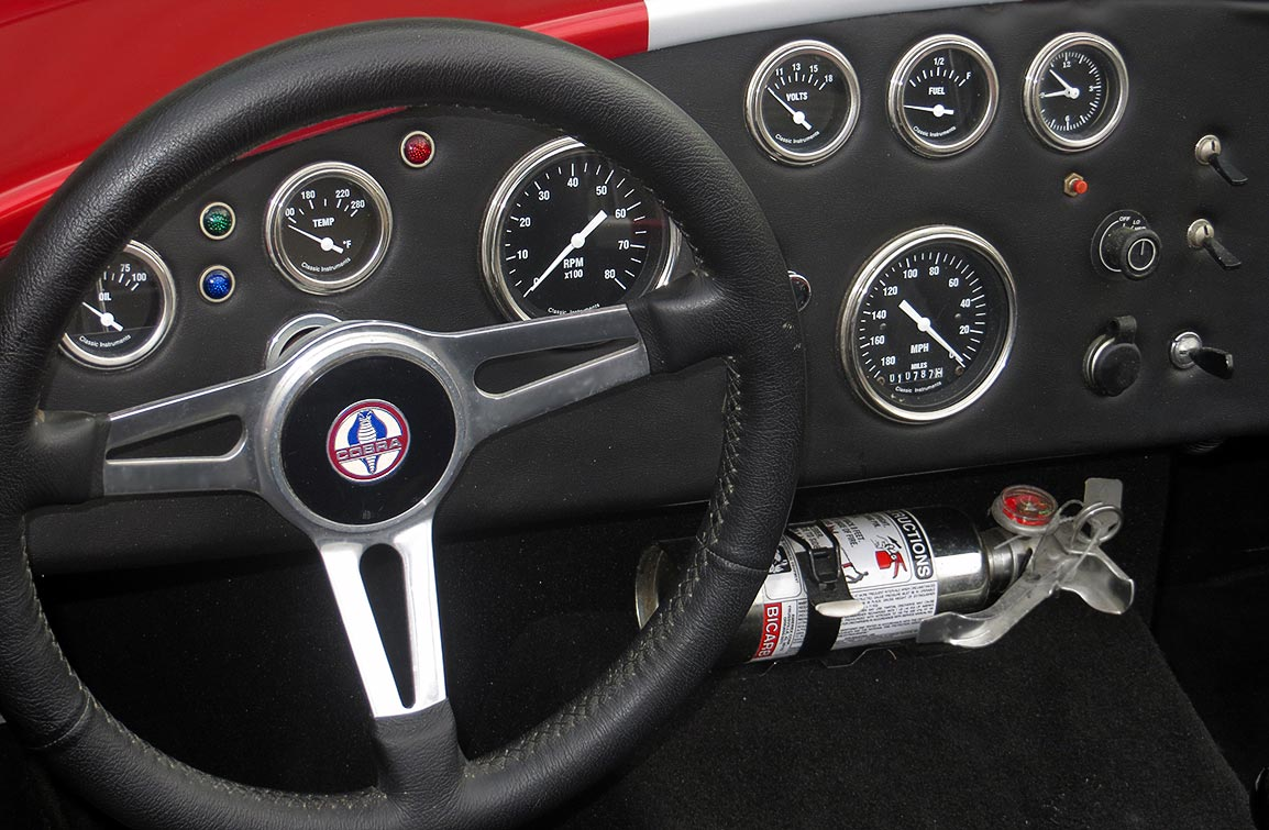 nstrument panel shot#1 (from driver side) of metallic red Factory Five Racing MkII 427SC Shelby classic Cobra for sale