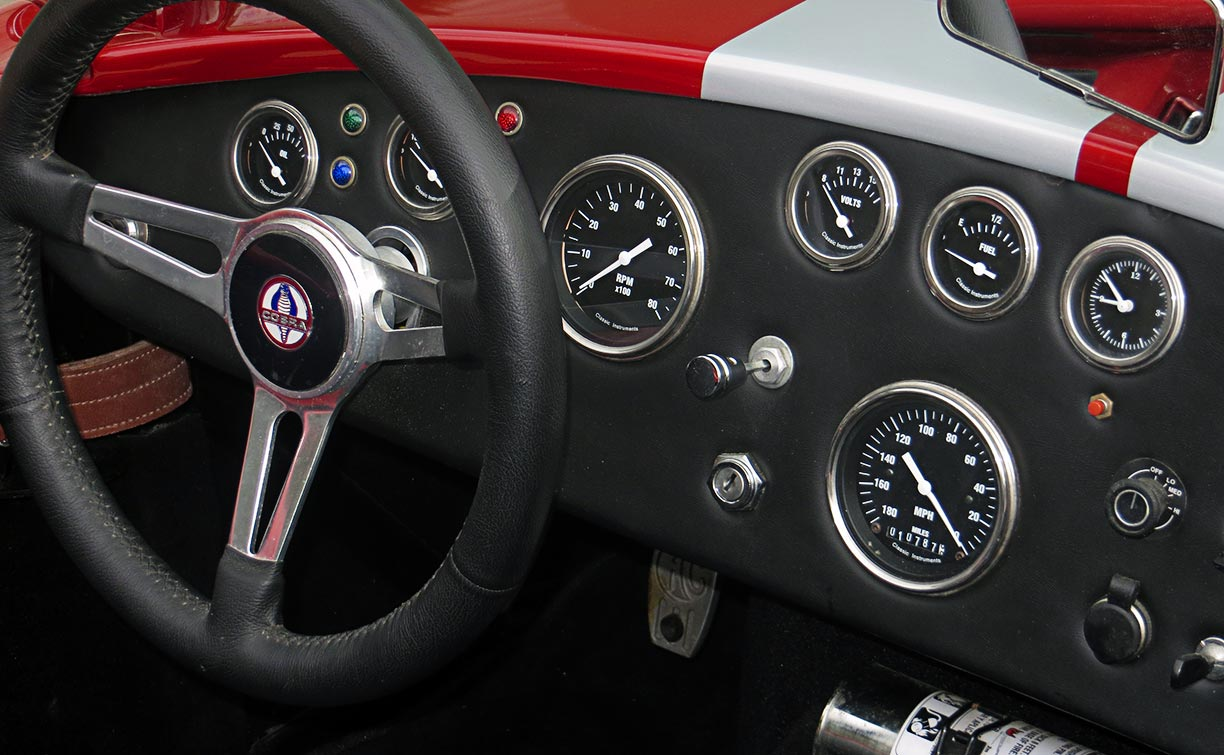 instrument panel shot#2 (from passenger side) of metallic red Factory Five Racing MkII 427SC Shelby classic Cobra for sale