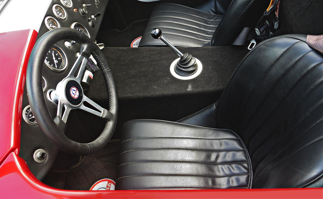 seating area shot (from driver side) of metallic red Factory Five Racing MkII 427SC Shelby classic Cobra for sale