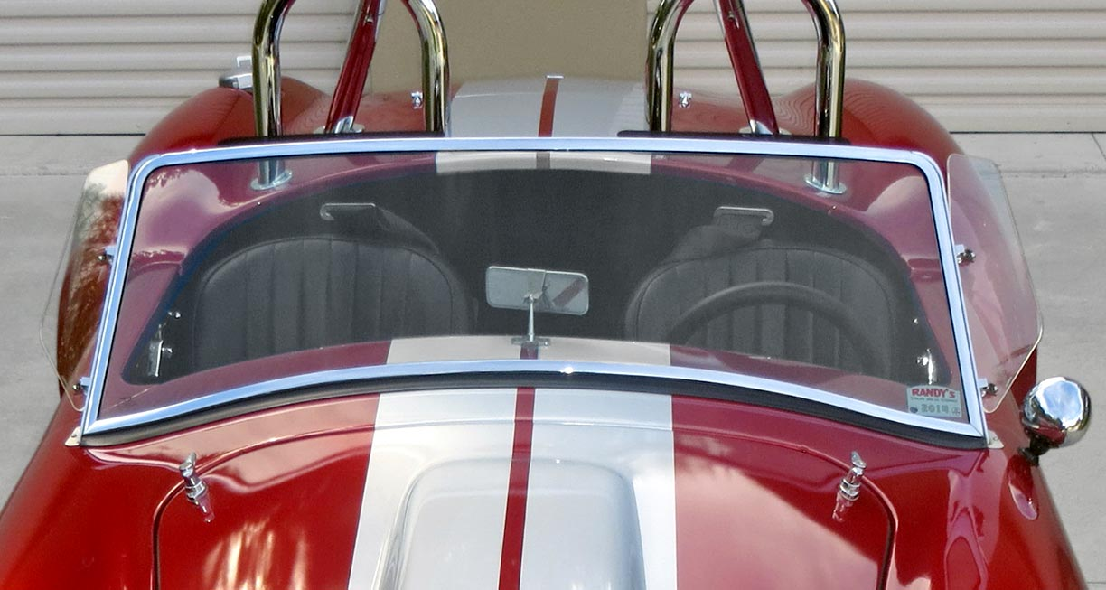 elevated shot of cockpit and rollbars of metallic red Factory Five Racing MkII 427SC Shelby classic Cobra for sale