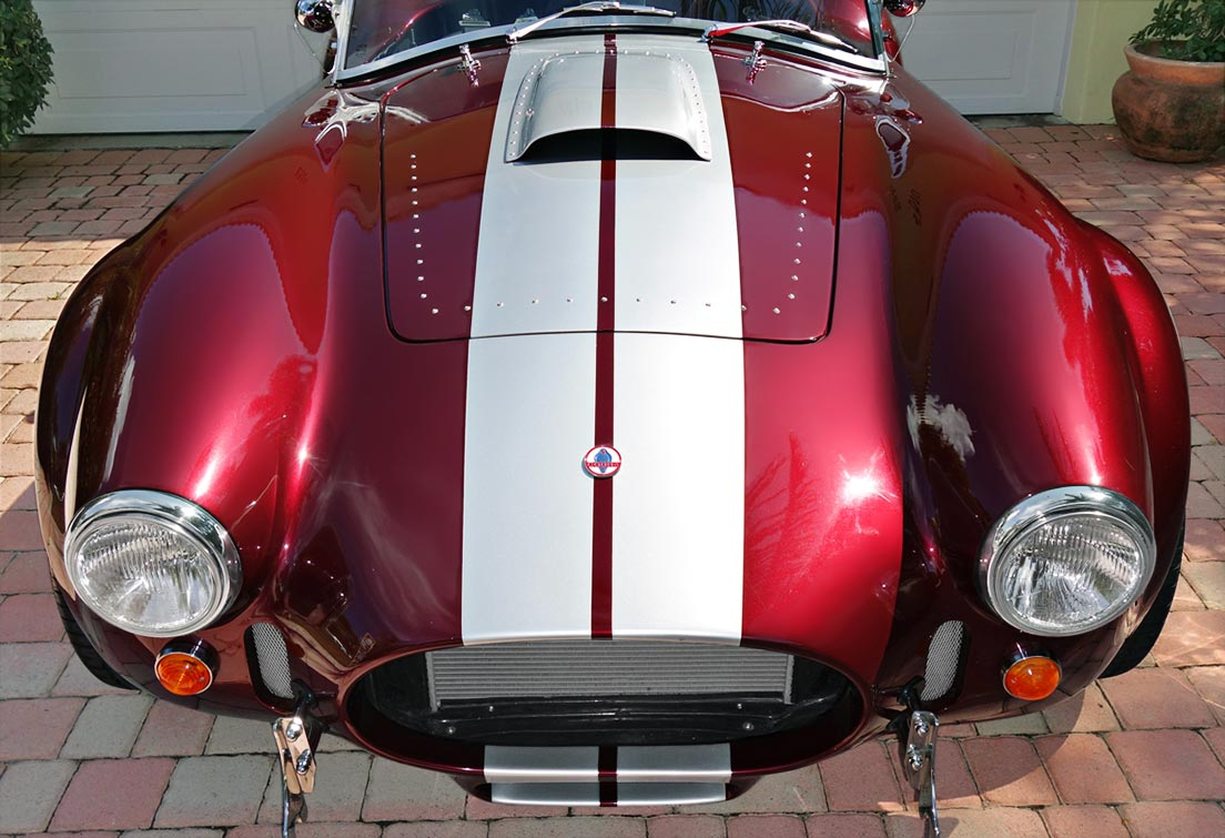 head-on frontal shot of Prism Red 427SC Shelby classic Backdraft Cobra for sale by owner