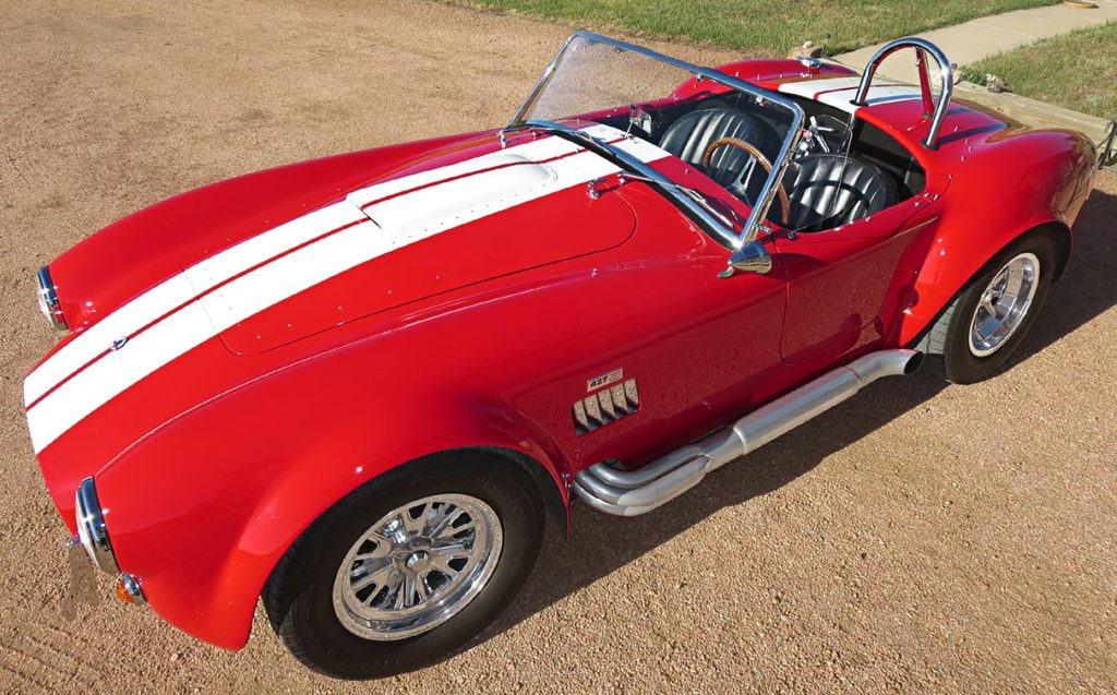 aerial 3/4-frontal photo (from driver side) of Monza Red Superformance 427SC Cobra for sale by owner, SPO#0666