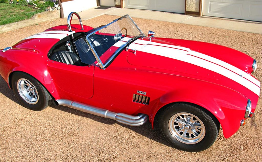 aerial broadside photo (from passenger side) of Monza Red Superformance 427SC Cobra for sale by owner, SPO#0666