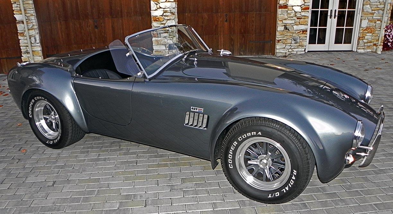 broadside image#1 (passenger side) of Superformance MkIII 'Street Version' 427 Cobra for sale by owner, SP03339. Dark silver/black upholstery.