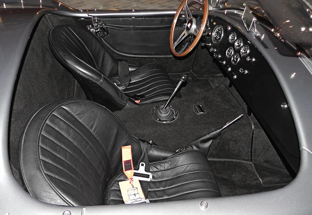 cockpit shot (from passenger side) of Superformance MkIII 'Street Version' 427 Cobra for sale by owner, SP03339. Dark silver/black upholstery.