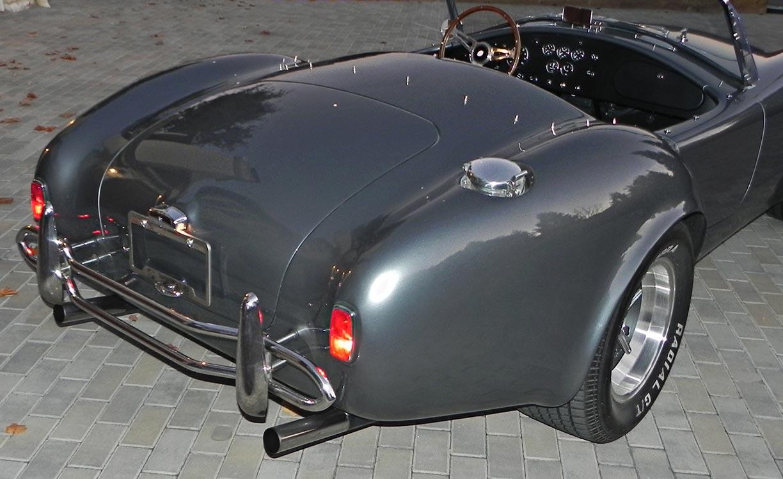 rear-quarter shot (passenger side) of Superformance MkIII 'Street Version' 427 Cobra for sale by owner, SP03339. Dark silver/black upholstery.