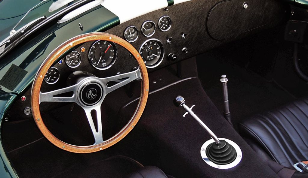 photo (from driver side) of dashboard and glovebox in this Malachite Green Superformance 427SC Cobra for sale, SPO1310