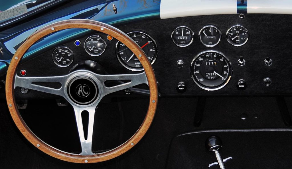 closeup photo of Moto-Lita wheel and Smiths Instruments blackfaced gauges in this Malachite Green Superformance 427SC Cobra for sale, SPO1310