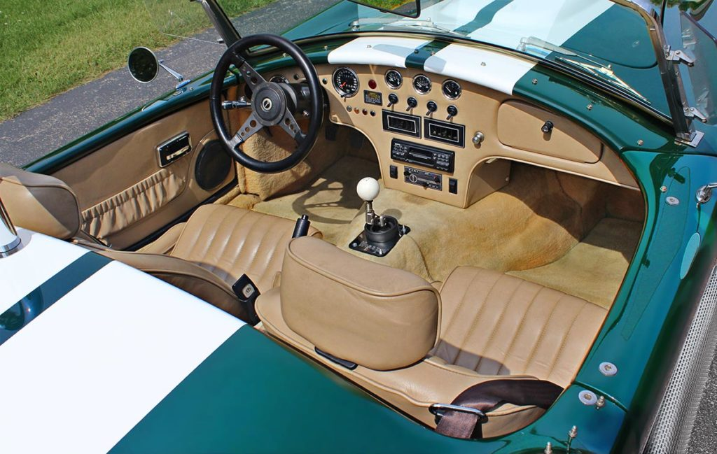 cockpit shot of BRG (British Racing Green) Excalibur 427SC Shelby classic Cobra for sale