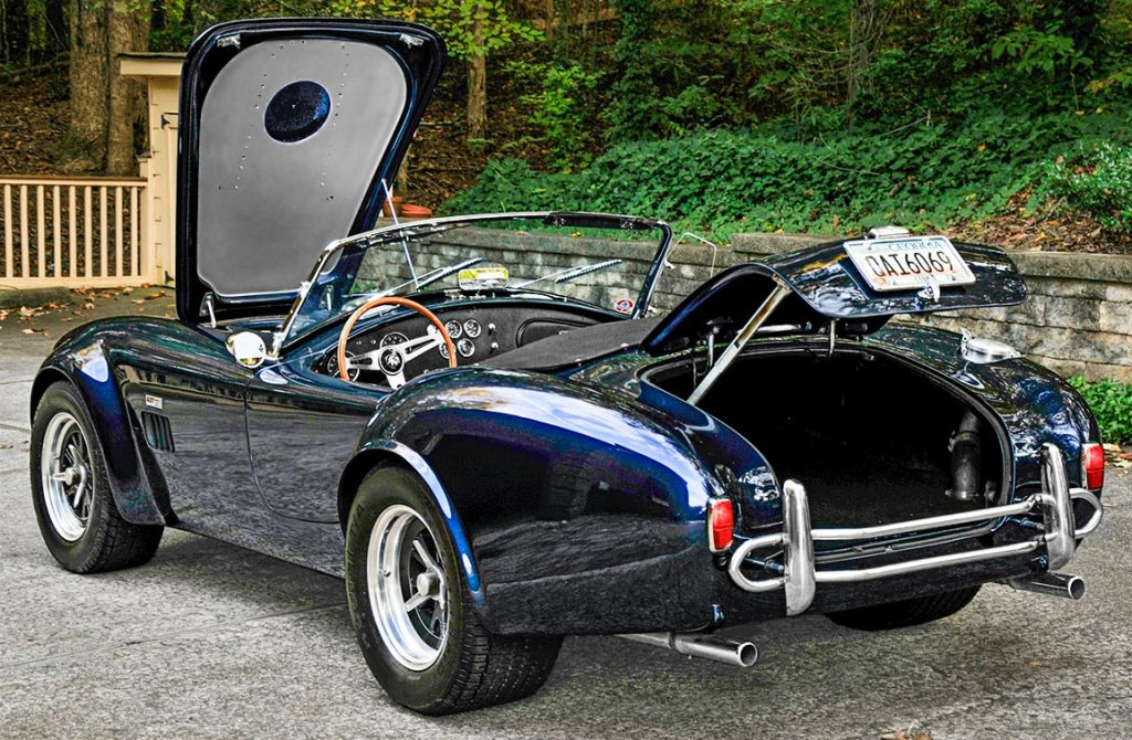 'decks open' shot (showing the aluminum-finished underside of bonnet) on Shelby Navy Blue Contemporary Classic 427 'Street Version' Shelby Cobra for sale, CCX-3-3835