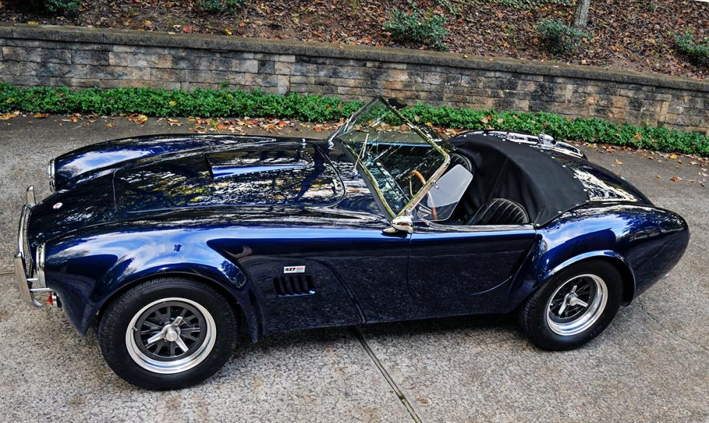 broadside aerial shot of Shelby Navy Blue Contemporary Classic 427 'Street Version' Shelby Cobra for sale, CCX-3-3835
