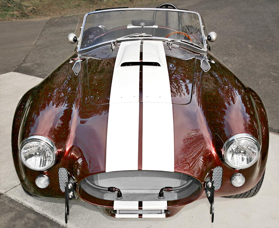 head-on frontal shot of Chesnut Metallic Superformance 427SC Shelby classic Cobra for sale, SPO1886 for sale